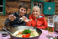Mayrhofen, Zillertal, Tyrol, Austria. After climbing the Nasenwand Klettersteig, we endulge ourselves in a pan of kasnocken, cheese gnochi at a traditional alpine alm hut. The Zillertal region offers at least 5 via ferrata climbing routes, better known as Klettersteige. Photo by Frits Meyst/Adventure4ever.com