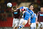 St Johnstone v Hearts..15.12.12      SPL.Marius Zaliukas clears from Steven MacLean.Picture by Graeme Hart..Copyright Perthshire Picture Agency.Tel: 01738 623350  Mobile: 07990 594431