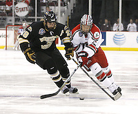 Ohio State's Max McCormick (17),right, and Western Michigan's Luke Witkowski (28) fight for control of the puck during a NCAA hockey game at Value City Arena, Friday, Feb. 15, 2013 in Columbus, Ohio. (Photo for the Dispatch by Mike Munden)