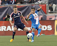 Philadelphia Union midfielder Daniel Cruz (44) attempts to control the ball as New England Revolution midfielder/defender Chris Tierney (8) defends..  In a Major League Soccer (MLS) match, the New England Revolution (blue/red) defeated Philadelphia Union (blue/white), 2-0 at Gillette Stadium on April 27, 2013.
