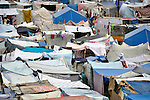 Families continue to pour into a camp for homeless families in the Belair section of Port-au-Prince, Haiti. The country was wracked by a devastating earthquake on January 12, 2010.