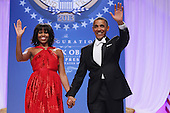 United States President Barack Obama and first lady Michelle Obama arrive for the Inaugural Ball at the Walter Washington Convention Center January 21, 2013 in Washington, DC. President Obama started his second term by taking the Oath of Office earlier in the day during a ceremony on the West Front of the U.S. Capitol. .Credit: Chip Somodevilla / Pool via CNP