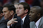 29 December 2010: Coaches Rob Judson, Tim Jankovich and Anthony Beane during an NCAA basketball game where the Creighton Bluejays defeated the Illinois State Redbirds at Redbird Arena in Normal Illinois.