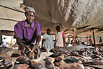 Rose Tumalu sells dried fish in the market in Yei, Southern Sudan, supported by a microfinance program run by the United Methodist Women in Yei.
