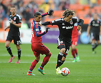Washington D.C. - March 29, 2014: Nick DeLeon (14) of D.C. United goes against Benji Joya of the Chicago Fire.  The Chicago Fire tied D.C. United 2-2 during a Major League Soccer match for the 2014 season at RFK Stadium.