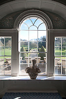 A Georgian window on the staircase landing has views over the formal garden