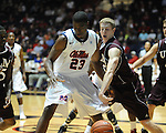 "Ole Miss' Reggie Buckner (23) has the ball stripped by Louisiana Monroe's trey Lindsey (35) at the C.M. ""Tad"" Smith Coliseum in Oxford, Miss. on Friday, November 11, 2011. Ole Miss won 60-38 in the season opener."