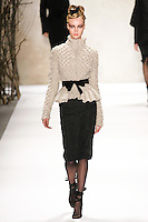 Kristy Kaurova walks runway in a Monique Lhuillier Fall 2011 outfit, during Mercedes-Benz Fashion Week Fall 2011.