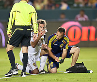CARSON, CA – August 27, 2011: Real Salt Lake midfielder Kyle Beckerman (5) gets tended to by a trainer during the match between Chivas USA and Real Salt Lake at the Home Depot Center in Carson, California. Final score Chivas USA 0, Real Salt Lake 1.