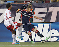 New England Revolution defender Chris Tierney (8) crosses the ball. In a Major League Soccer (MLS) match, the New England Revolution (blue) tied New York Red Bulls (white), 1-1, at Gillette Stadium on May 11, 2013.