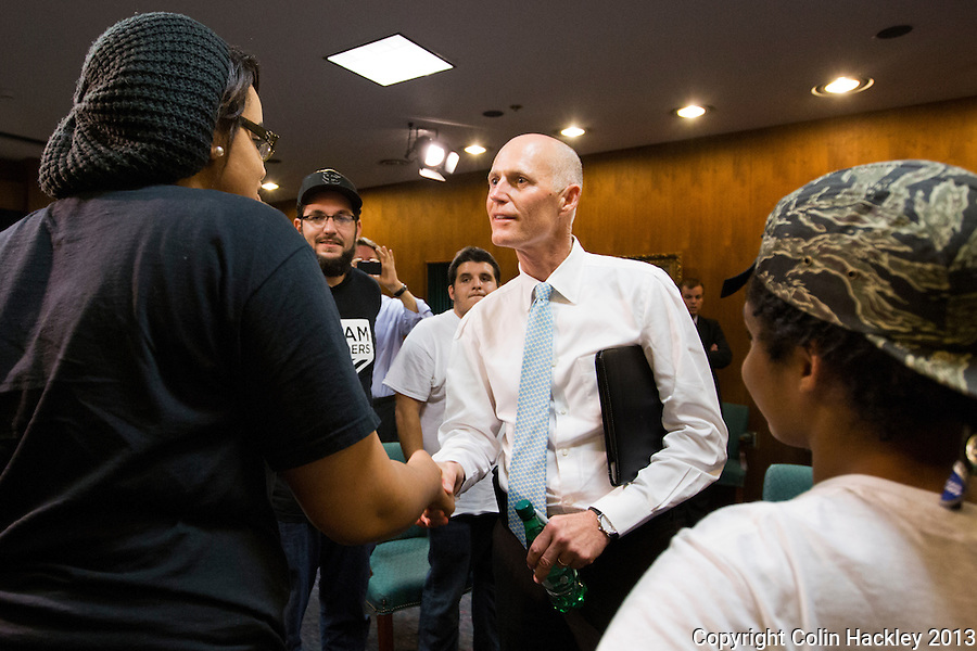 TALLAHASSEE, FLA. 07/18/13-TRAYVONOCCUPY0718013CH-Gov. Rick Scott, center, greets Nailah Summers, left and other representatives of the groups seeking justice for Trayvon Martin and a special session to repeal the stand your ground law, Thursday at the Capitol in Tallahassee. Scott said he would not call a special session.<br /> <br /> COLIN HACKLEY PHOTO
