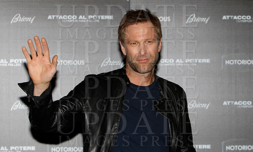 """L'attore statunitense Aaron Eckhart posa durante il photocall del film """"Attacco al potere"""" a Roma, 5 aprile 2013..U.S. actor Aaron Eckhart poses during the photocall of the movie """"Olympus has fallen"""" in Rome, 5 April 2013..UPDATE IMAGES PRESS/Isabella Bonotto."""
