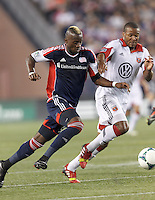 New England Revolution forward Dimitry Imbongo (92) on the attack as D.C. United defender Ethan White (15) defends. In a Major League Soccer (MLS) match, the New England Revolution (blue) defeated D.C. United (white), 2-1, at Gillette Stadium on September 21, 2013.