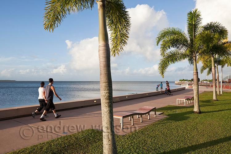 Couple walking along the Esplanade.  Cairns, Queensland, Australia