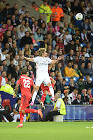 Cardiff City Stadium, Cardiff, South Wales - Tuesday 12th Aug 2014 - UEFA Super Cup Final - Real Madrid v Sevilla - <br /> <br /> Real Madrid&rsquo;s F&aring;bio Coentr&aring;o gets the highest for this ball against Sevilla&rsquo;s Aleix Vidal parreu. <br /> <br /> <br /> <br /> <br /> Photo by Jeff Thomas/Jeff Thomas Photography