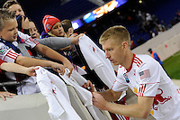 Tim Ream (5) of the New York Red Bulls signs autographs after the game. The New York Red Bulls defeated the New England Revolution 2-0 during a Major League Soccer (MLS) match at Red Bull Arena in Harrison, NJ, on October 21, 2010.