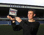 A young Kenny Miller pcks up the SPL young player of the month award in December 2000