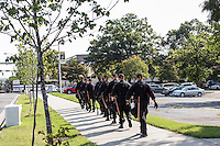 North Carolina Highway Patrol officers march near the security perimeter for the Democratic National Convention on Monday, September 3, 2012 in Charlotte, NC.