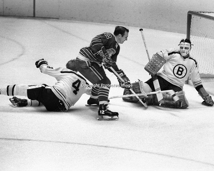 Seals vs Bruins..Bobby Orr helps goalie Ed Johnston.as Seals Gary Jarrett tries to score..1968 photo by Ron Riesterer