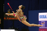 Alina Kabaeva of Russia split leaps to clubs toss at 2006 Aeon Cup Worldwide Clubs Championships in rhythmic gymnastics on November19, 2006.  (Photo note: Just found this of Alina and will be 'daypic' on my page late Sunday (California time))<br />