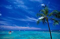 Sailboat off Waikiki with wispy clouds in sky, Oahu