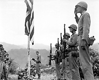Lt. Col. John Hopkins, commanding officer of the First Battalion, Fifth Marine Regiment, leads in singing the &quot;Star Spangled Banner&quot; during Memorial Services held in the field during the Korean campaign.  June 21, 1951. Cpl. Valle. (Marine Corps)<br /> NARA FILE #:  127-N-A9345<br /> WAR &amp; CONFLICT BOOK #:  1401
