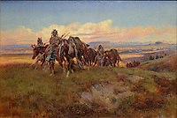 In the Enemy's Country, painting, oil on canvas, 1921, by Charles Marion Russell, American, 1864-1926, in the Denver Art Museum, Denver, Colorado, USA. The painting depicts Kootenai Indians crossing territory controlled by hostile Blackfeet. In a attempt to pass for buffalo, the hunters walk alongside horses draped with buffalo robes (notice how more distant figures start to look like buffalo). Picture by Manuel Cohen