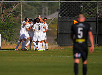 The Auckland team celebrates Ryan de Vries's goal during the Oceania Football Championship final (second leg) football match between Team Wellington and Auckland City FC at David Farrington Park in Wellington, New Zealand on Sunday, 7 May 2017. Photo: Dave Lintott / lintottphoto.co.nz