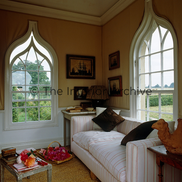 The gothic folly boasts a classical sitting room overlooking the garden