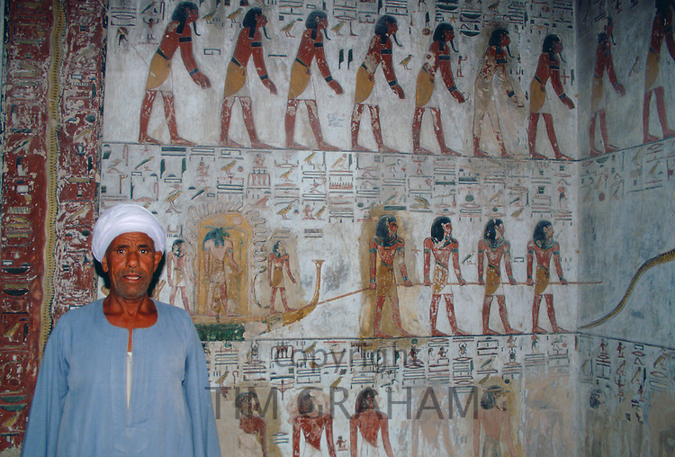 Egyptian man standing guard in King Seti's tomb in the Valley of the Kings, Luxor, Egypt