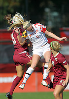 COLLEGE PARK, MD - OCTOBER 21, 2012:  Ashley Spivey (8) of the University of Maryland heads the ball against Tiana Brockway (15) of Florida State during an ACC women's match at Ludwig Field in College Park, MD. on October 21. Florida won 1-0.