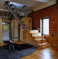 In the main entrance to the loft is a pebbled hot-tub fed by a water-spout concealed in the stairs