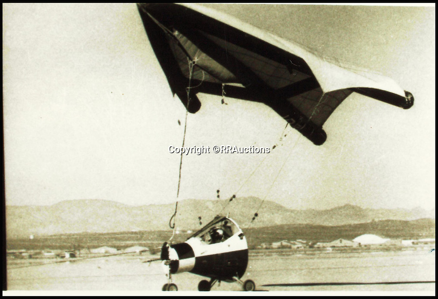 BNPS.co.uk (01202 558833)<br /> Pic: RRAuctions/BNPS<br /> <br /> ***Please Use Full Byline***<br /> <br /> Tests involving a Project Gemini capsule and a paraglider method of re-entry<br /> <br /> Space fans have got the chance to own a piece of history - after one of the capsules from the ground-breaking Gemini space missions of the 1960s emerged for sale.<br /> <br /> The 9ft capsule was used by NASA to test the design and handling of the spacecraft during the highly dangerous missions, which resulted in the first ever space walks.<br /> <br /> The Gemini missions paved the way for putting man on the moon with the Apollo space programme by testing longer space flights and perfecting methods of re-entry and landing.<br /> <br /> Experts at Boston saleroom RR Auction where it will go under the hammer are expecting it to fetch upwards of $50,000 - around &pound;35,000
