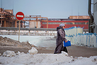 A Bashneft employee walks between refinery buildings outside Ufa, Bashkortostan, Russia.  The area is a major oil and gas producing region in the country.