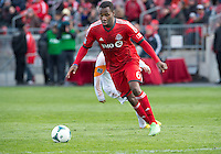 20 April 2013: Toronto FC defender Gale Agbossoumonde #62 in action during an MLS game between the Houston Dynamo and Toronto FC at BMO Field in Toronto, Ontario Canada..The game ended in a 1-1 draw...