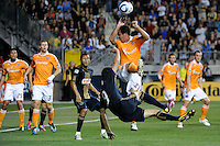 Hunter Freeman (21) of the Houston Dynamo defends the bicycle kick of Sebastien Le Toux (9) of the Philadelphia Union. The Philadelphia Union and the Houston Dynamo played to a 1-1 tie during a Major League Soccer (MLS) match at PPL Park in Chester, PA, on August 6, 2011.