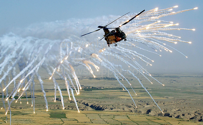 British Chinook Helicopter, flown by Wg Cdr Sean Reynolds and Co-pilot Steve Collings, release counter measures as a drill over Afghanistan...PICTURE: HELEN ATKINSON