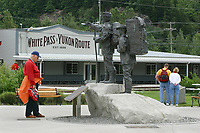 Statue of a Gold Rush guide and explorer sits at the center of Skagway Centennial Park, located on Broadway St., Skagway, Alaska. Oldest incorporated city in Alaska. It takes its name from the Tlingit Indian word meaning home of the north wind. Often called the gateway to the Klondike, accessible by air, sea, road and the historic White Pass & Yukon Route Co. railroad.,