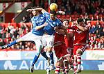 Aberdeen v St Johnstone...03.10.15   SPFL   Pittodrie, Aberdeen<br /> Murray Davidson and Graham Cummins get above Adam Rooney<br /> Picture by Graeme Hart.<br /> Copyright Perthshire Picture Agency<br /> Tel: 01738 623350  Mobile: 07990 594431