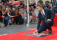 Actor Ryan Reynolds at the Hollywood Walk of Fame Star Ceremony honoring actor Ryan Reynolds. Wife Blake Lively in background on left.<br /> Los Angeles, CA. <br /> December 15, 2016<br /> Picture: Paul Smith/Featureflash/SilverHub 0208 004 5359/ 07711 972644 Editors@silverhubmedia.com