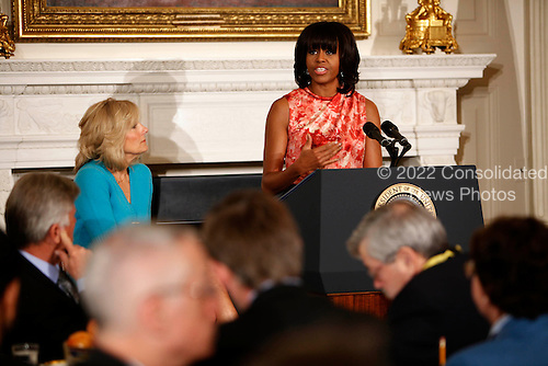 Dr. Jill Biden listens as first lady Michelle Obama addresses the National Governors Association in the State Dining Room of the White House in Washington, D.C. on February 25, 2013..Credit: Dennis Brack / Pool via CNP