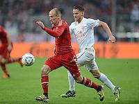 FUSSBALL   1. BUNDESLIGA  SAISON 2011/2012   31. Spieltag FC Bayern Muenchen - FSV Mainz 05       14.04.2012 Arjen Robben (li, FC Bayern Muenchen) gegen Eugen Polanski (1. FSV Mainz 05)