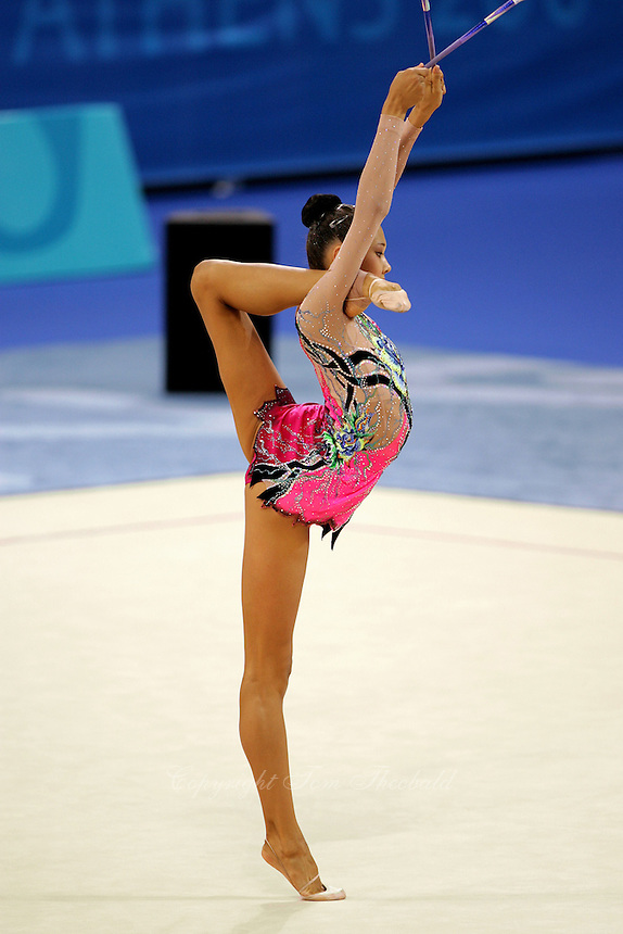 Aliya Yussupova competing for Kazakhstan holds balance in ring position with clubs during All-Around final at Athens Olympic Games on August 29, 2004 at Athens, Greece. (Photo by Tom Theobald)