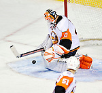 26 October 2009: New York Islanders' goaltender Martin Biron makes a second period save against the Montreal Canadiens at the Bell Centre in Montreal, Quebec, Canada. The Canadiens defeated the Islanders 3-2 in sudden death overtime for their 4th consecutive win. Mandatory Credit: Ed Wolfstein Photo