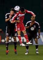 Marco Pappa (16) of the Chicago Fire goes up for a header against Devon McTavish (18) of DC United at RFK Stadium in Washington, DC.  The Chicago Fire defeated DC United, 2-0.