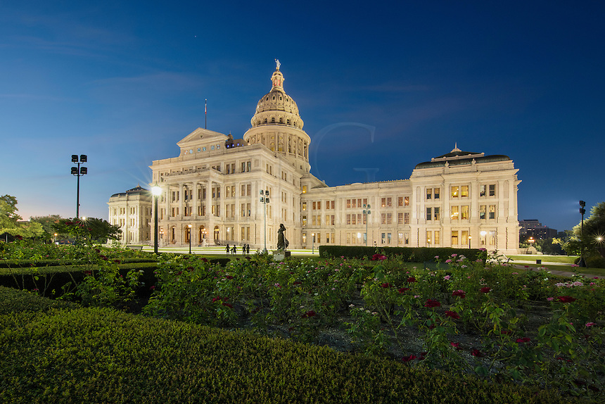 Exploring the 22 acres of the Texas State Capitol complex is seemingly always rewarding. Flowers and roses bloom at different times of the year, and the changing of the seasons also bring fall colors to some of the trees that grow on the land. In this image, a flower garden rests in the first light of an Autumn morning and provides color to a beautiful start of the day.