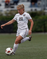 Harvard University midfielder Lauren Urke (20) dribbles at midfield. In overtime, Harvard University defeated Yale University,1-0, at Soldiers Field Soccer Stadium, on September 29, 2012.