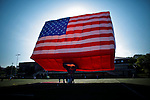 People take part in the World's Largest Free-Flying Flag Honors America special shaped hot balloon as preparation of America's birthday and Independence Day in Hoboken.  Photo by Eduardo Munoz Alvarez / VIEW..