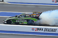Apr. 15, 2012; Concord, NC, USA: NHRA funny car driver Alexis DeJoria during the Four Wide Nationals at zMax Dragway. Mandatory Credit: Mark J. Rebilas-