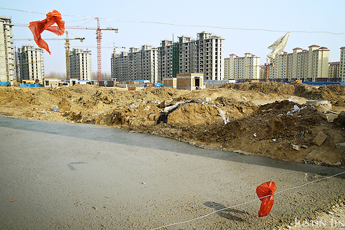A building site in Hebei, on the outskirts of Beijing, where rural land is increasingly destroyed to make way for urbanisation. <br /> <br /> China is pushing ahead with a dramatic, history-making plan to move 100 million rural residents into towns and cities over six years &mdash; but without a clear idea of how to pay for the gargantuan undertaking or whether the farmers involved want to move.<br /> <br /> Moving farmers to urban areas is touted as a way of changing China&rsquo;s economic structure, with growth based on domestic demand for products instead of exporting them. In theory, new urbanites mean vast new opportunities for construction firms, public transportation, utilities and appliance makers, and a break from the cycle of farmers consuming only what they produce.<br /> <br /> Urbanization has already proven to be one of the most wrenching changes in China&rsquo;s 35 years of economic reforms. Land disputes rising from urbanization account for tens of thousands of protests each year.